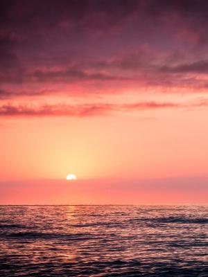 日落在海上移动壁纸